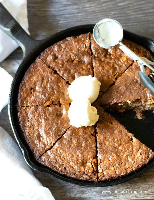 a giant oatmeal cookie that was baked in a cast iron skillet