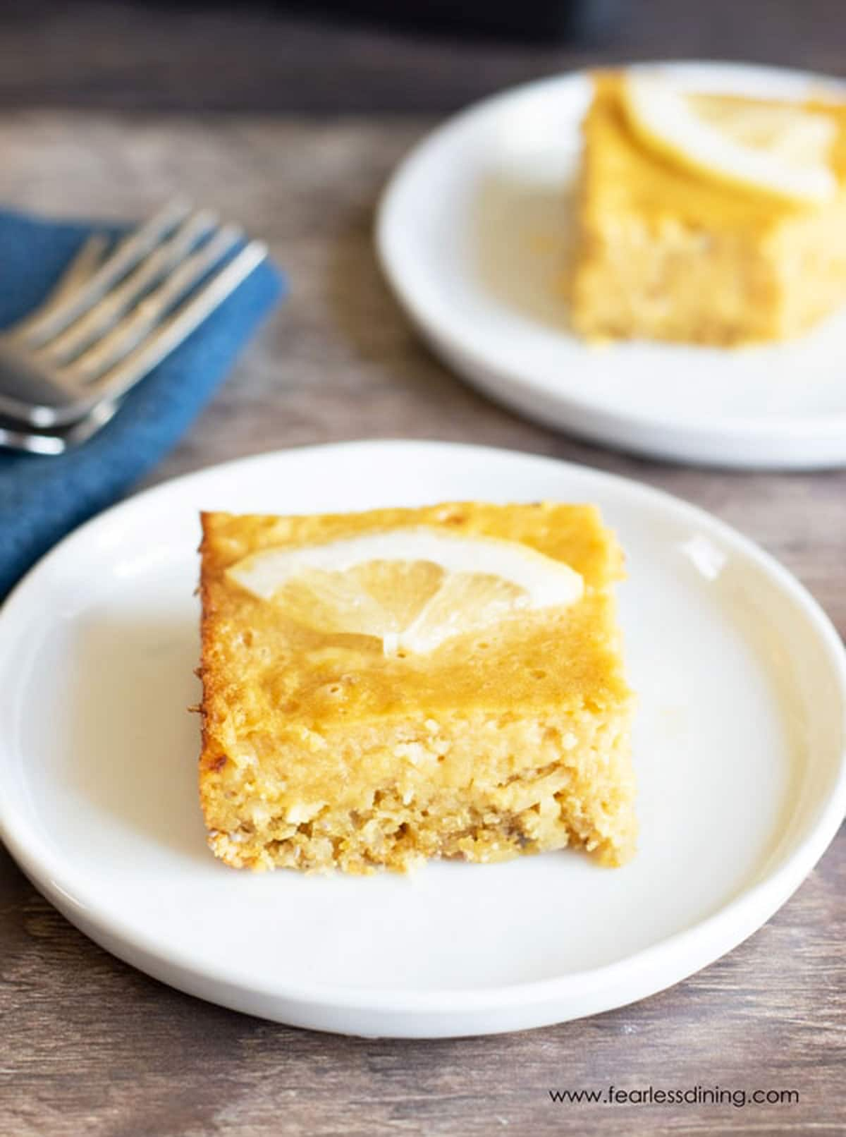 a close up picture of the lemon bar on a plate