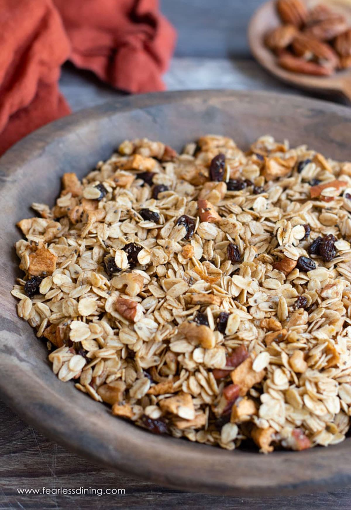 a wooden bowl of granola