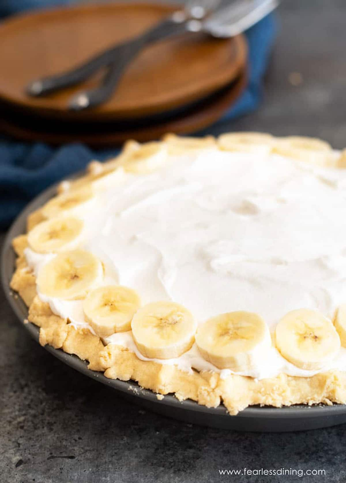 a whole gluten free banana cream pie on a table