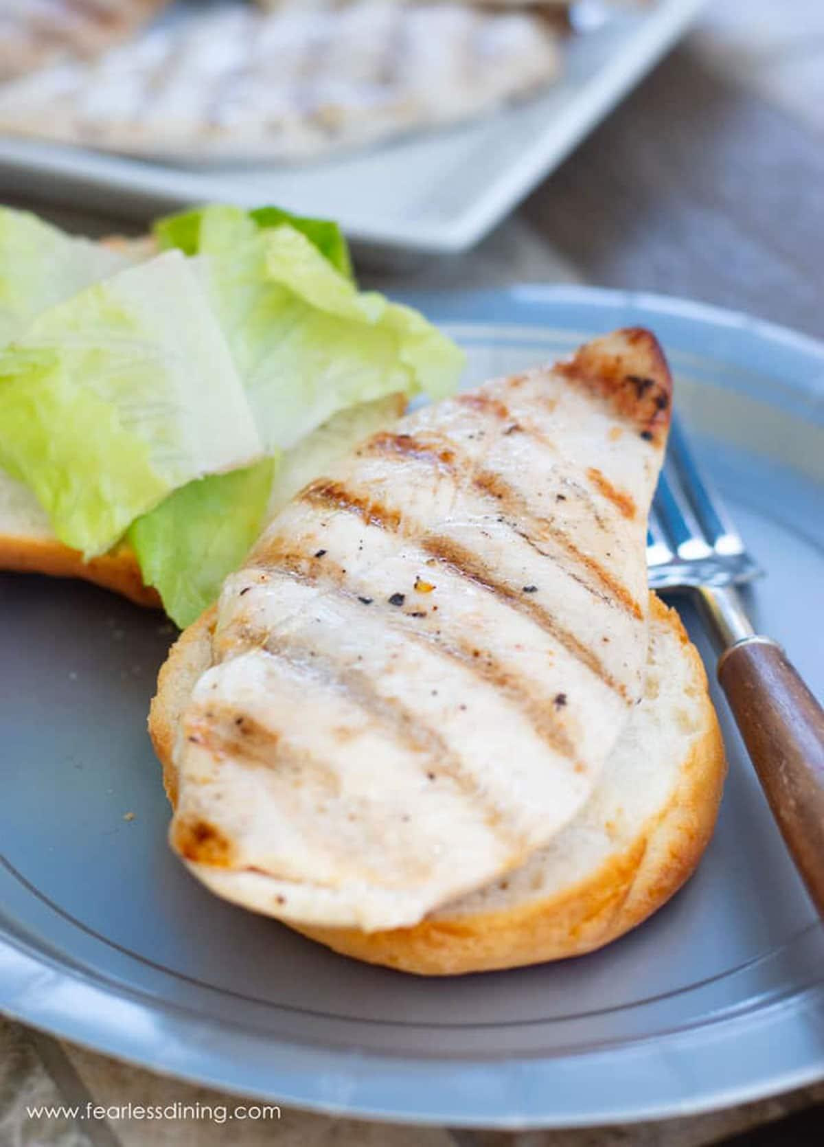 a grilled chicken breast on a gluten free bun
