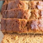 a pinterest pin of a loaf of honey cake sliced on a cutting board