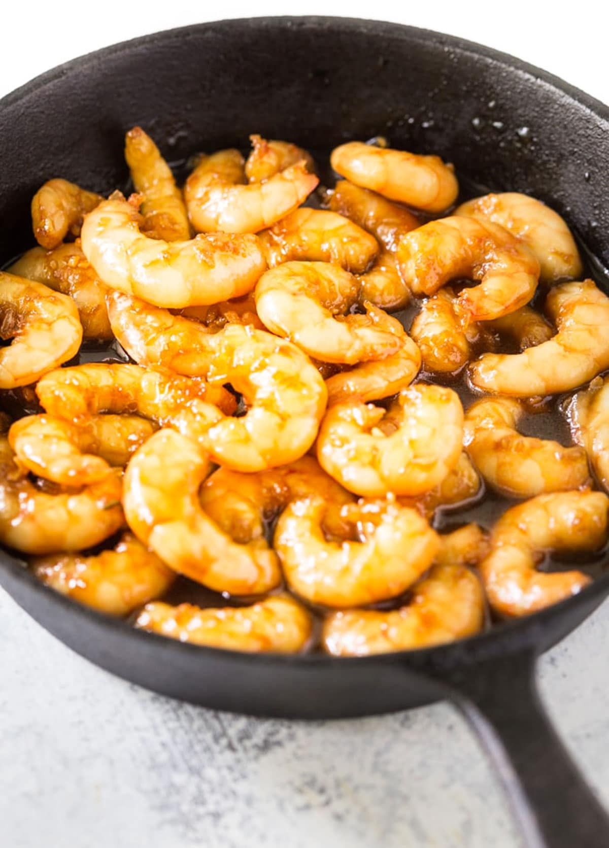 cooked honey shrimp in a pan