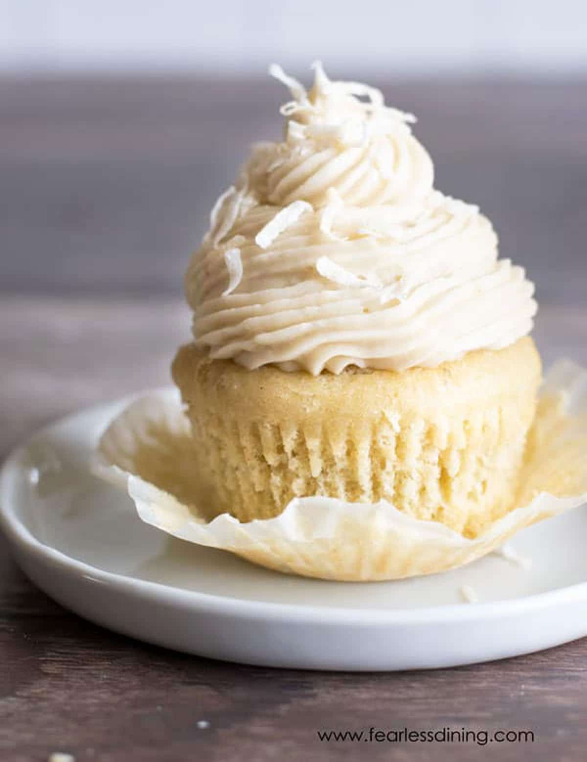 a cupcake with the cupcake wrapper peeled back