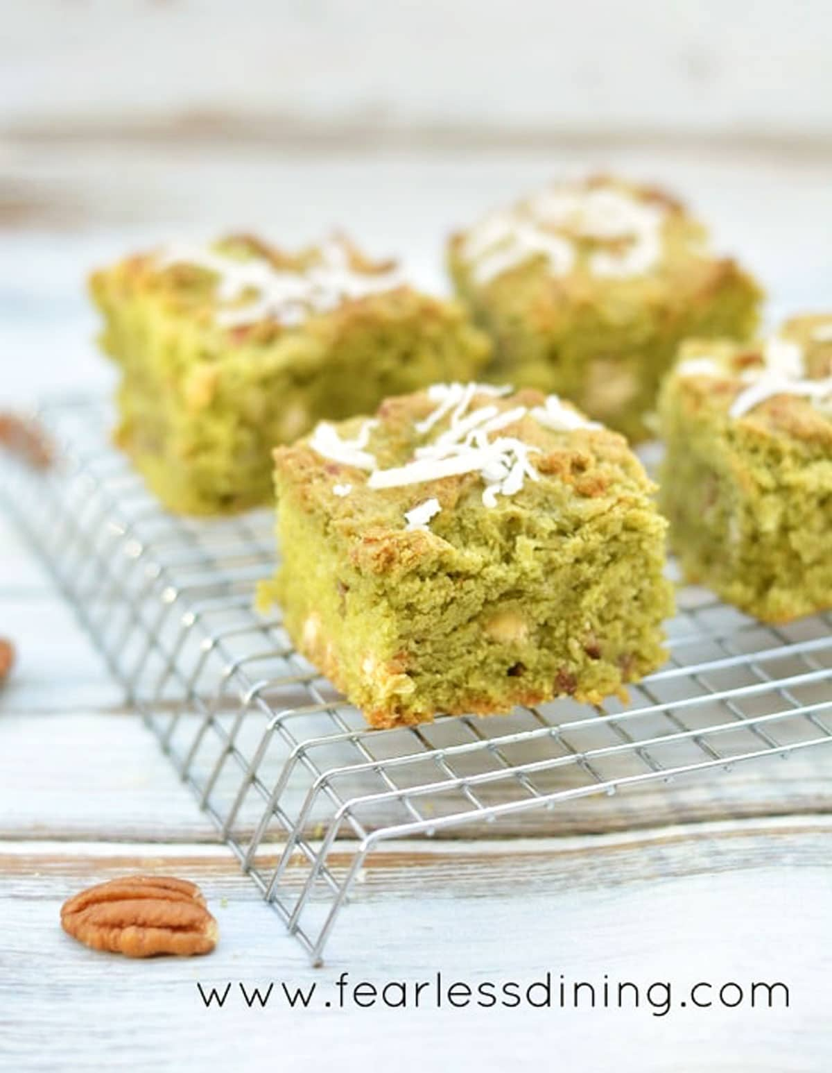 matcha cookie bars on a cooling rack