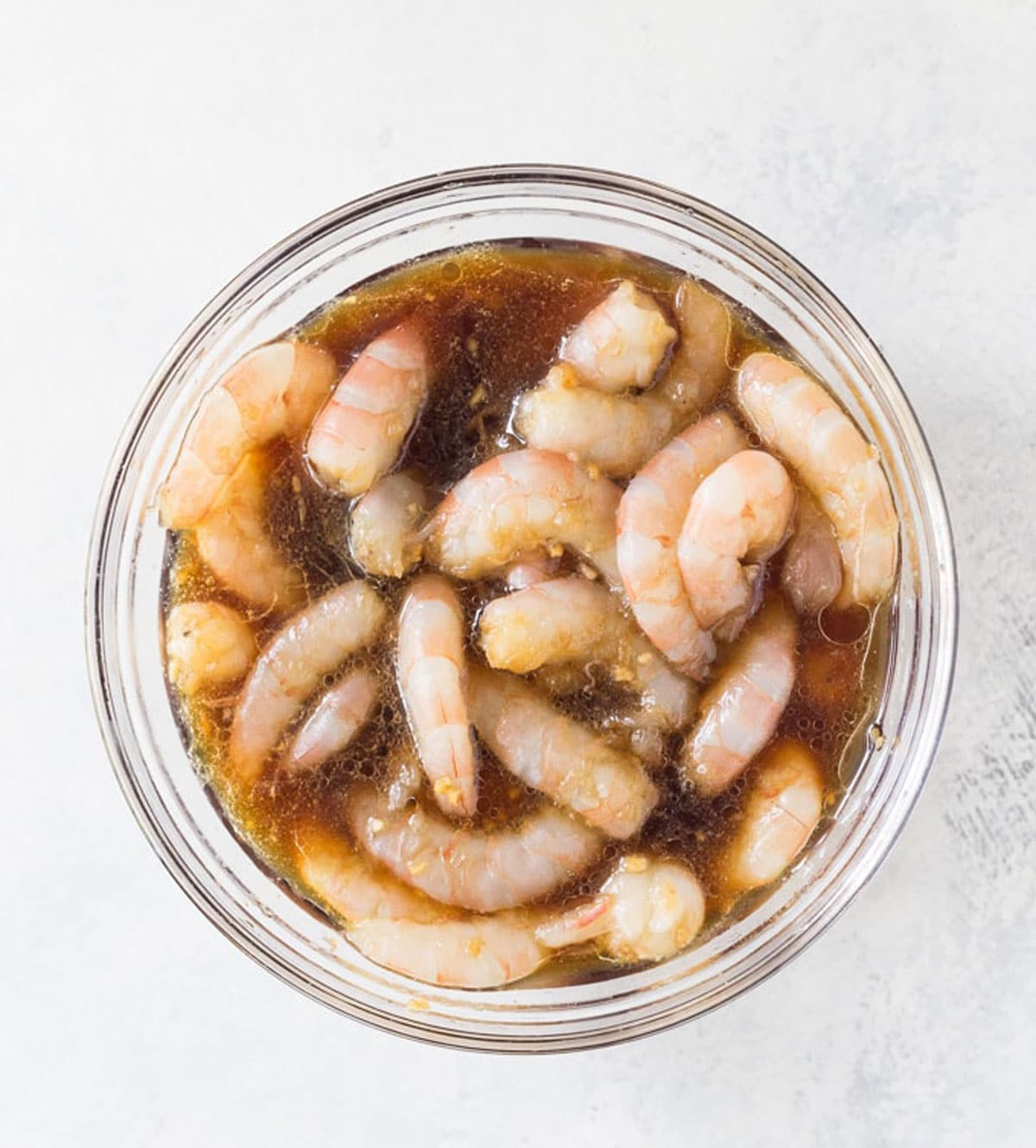 raw shrimp in a bowl with marinade
