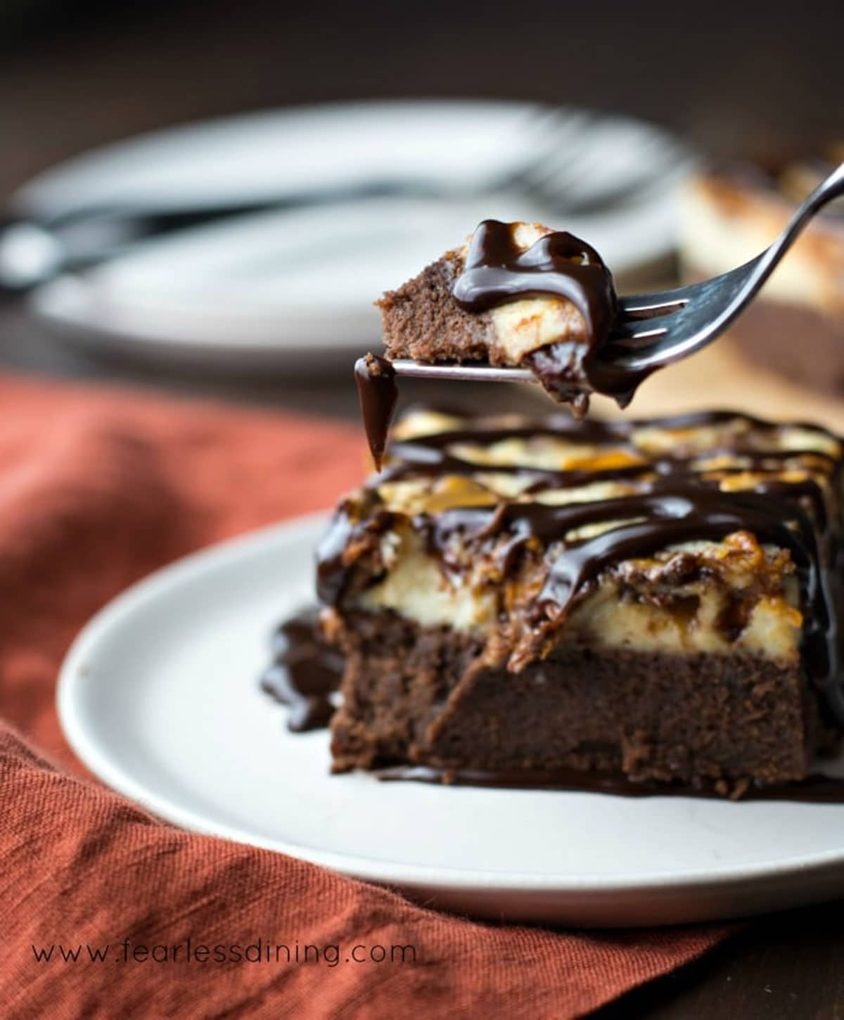 a forkful of brownie cheesecake