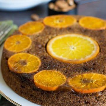 a gluten free orange cake on a cake plate