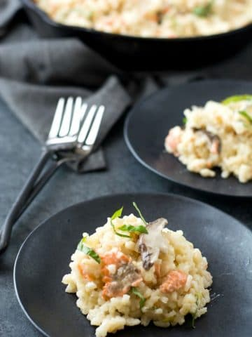 two black plates with gluten free risotto