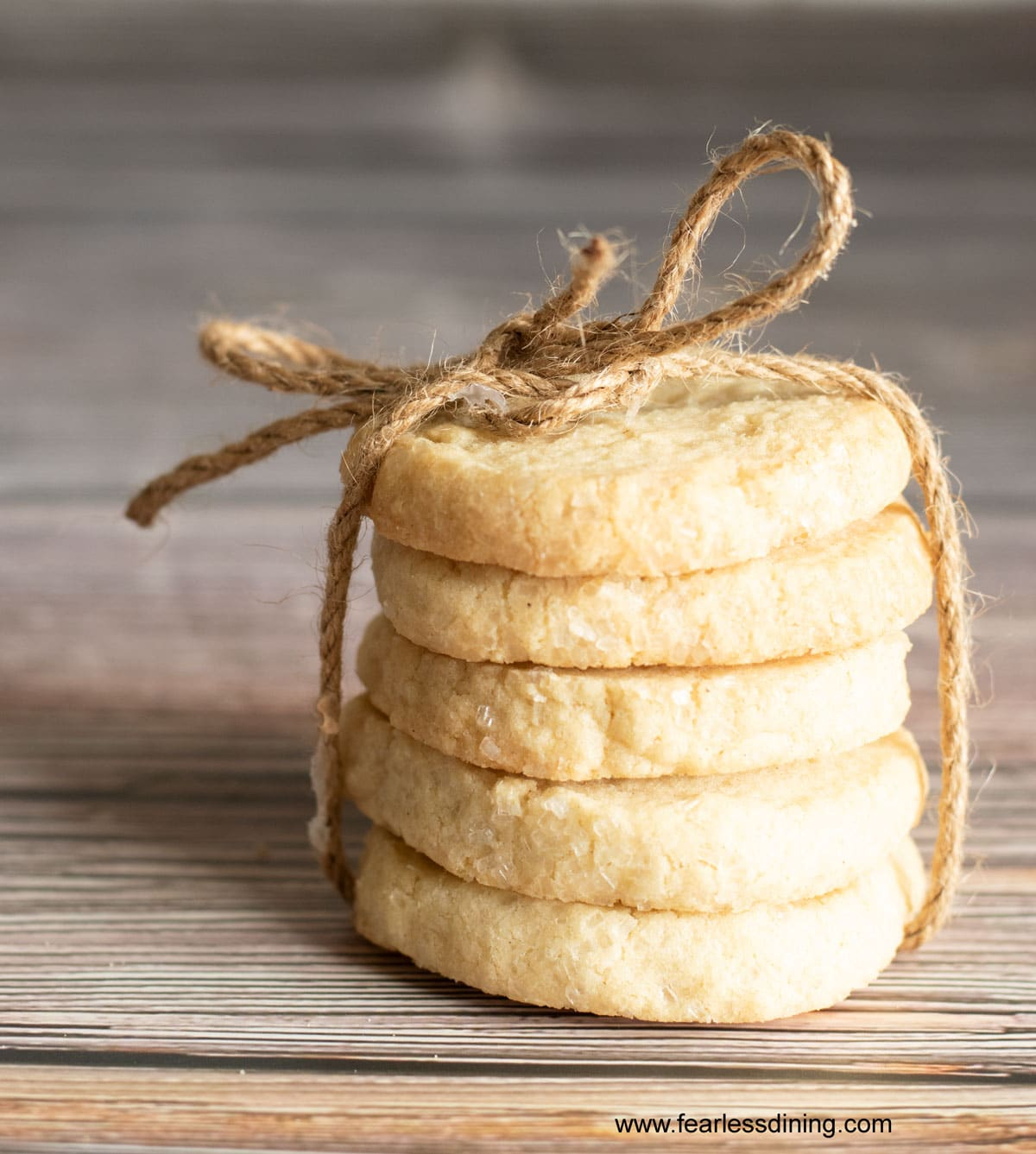 five sables stacked and tied with twine