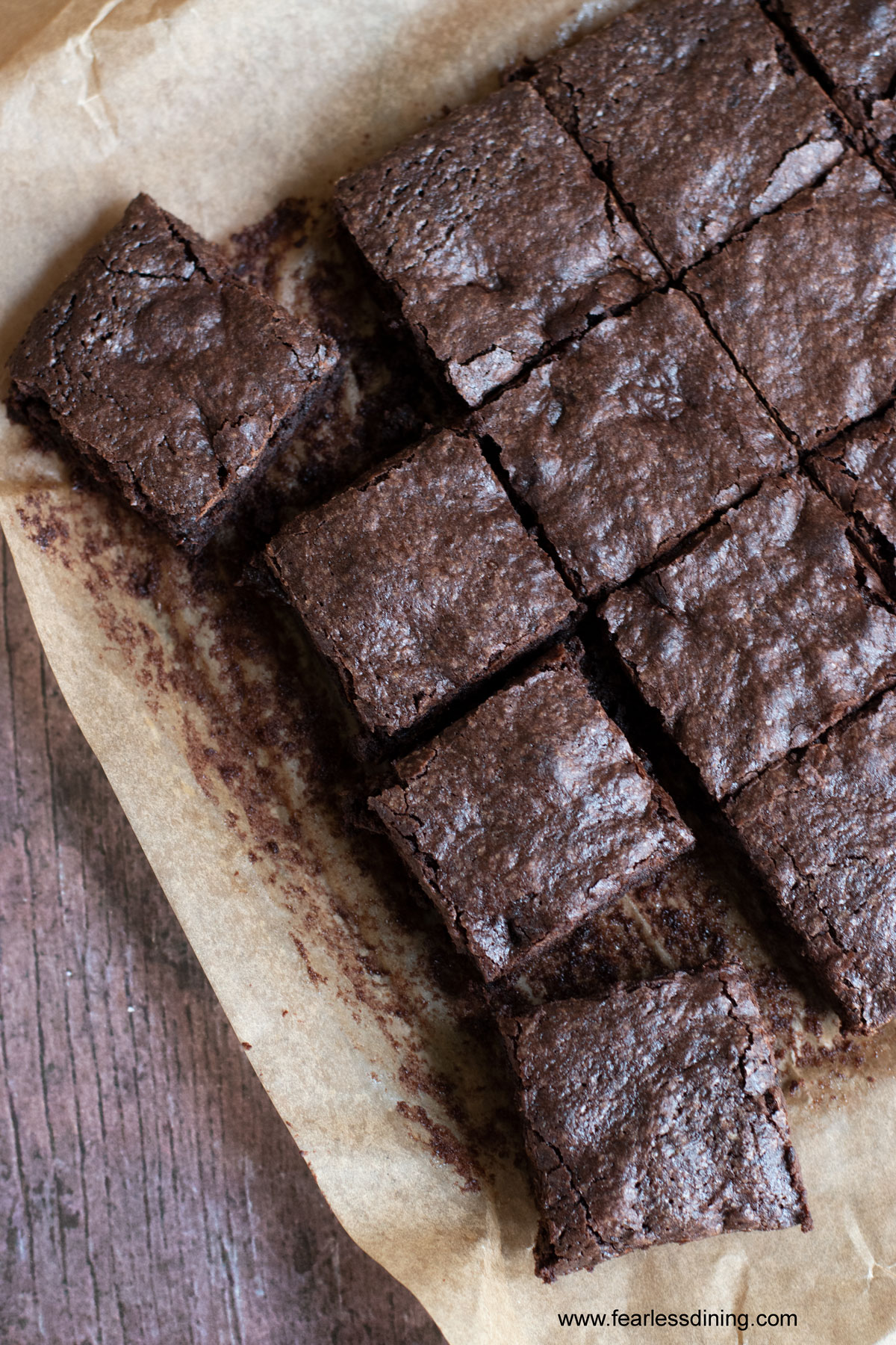a tray of cut gluten free brownies