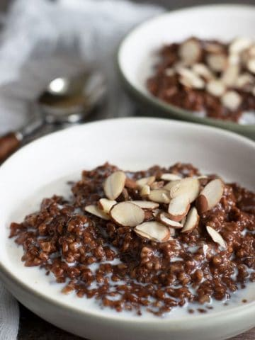 two bowls of gluten free chocolate steel cut oats
