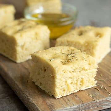 slices of gluten free focaccia bread on a cutting board