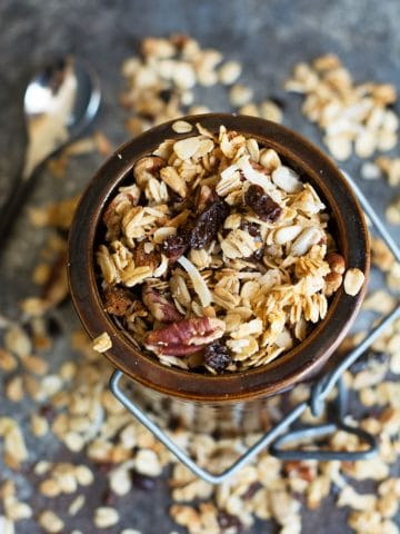 a ceramic jar filled with granola