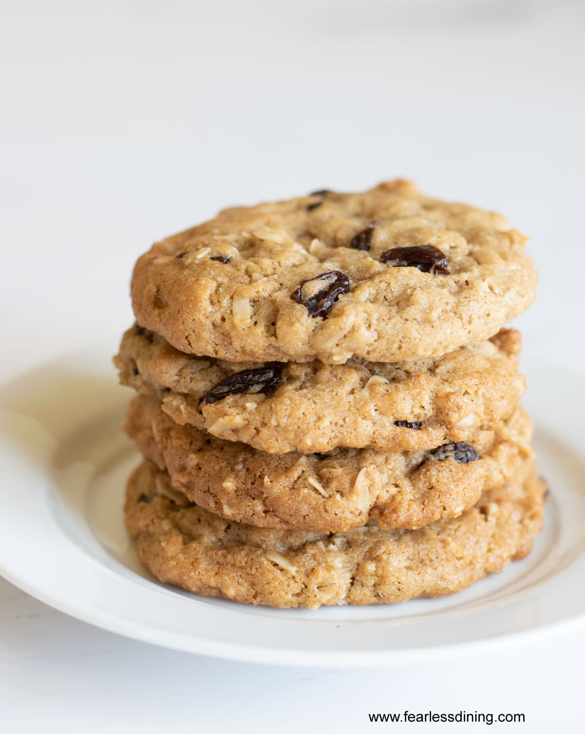 a stack of oatmeal raisin cookies on a plate