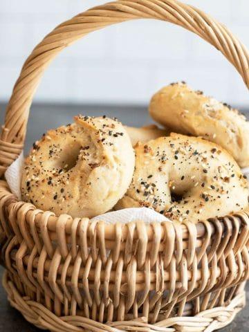 a wicker basket full of gluten free bagels