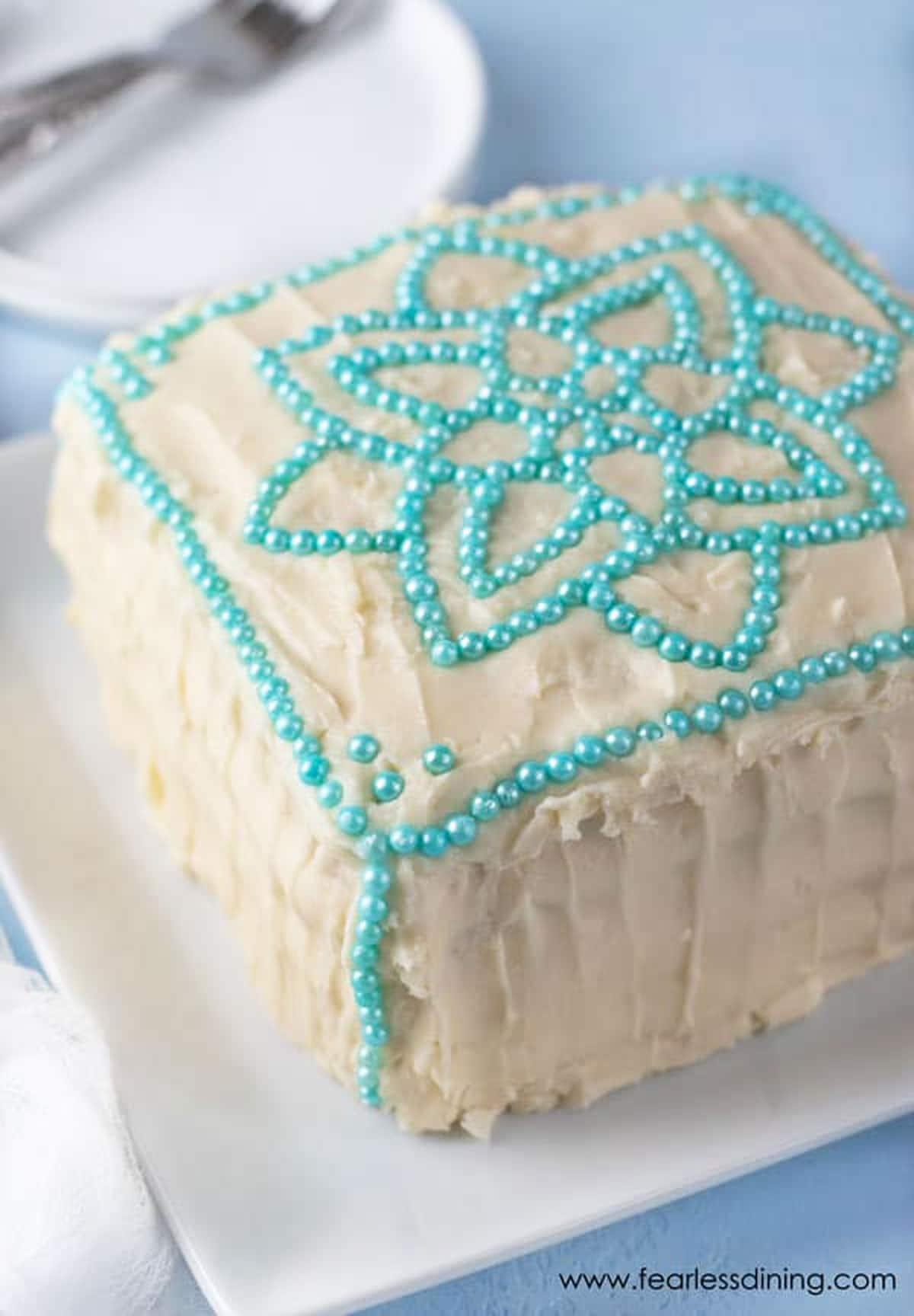 a decorated square shaped vanilla cake