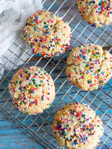 a cooling rack with sprinkles cookies