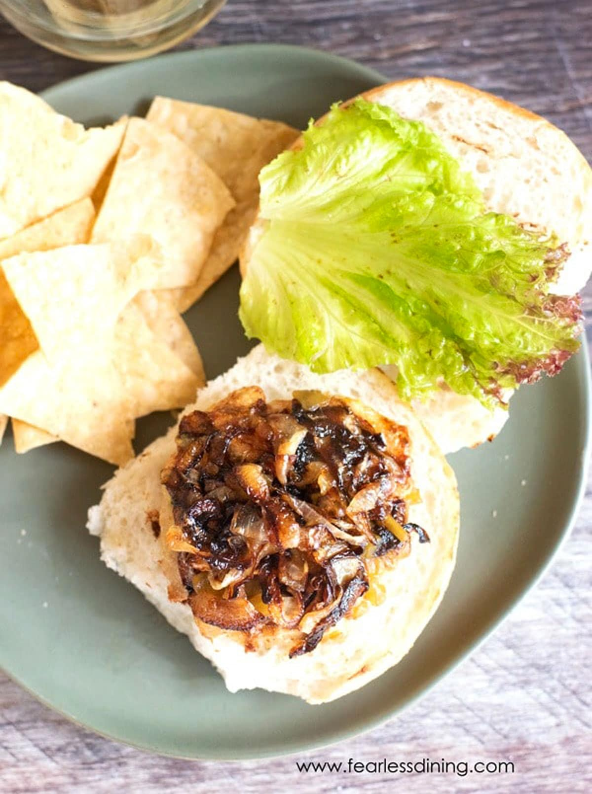 the top view of a ground chicken burger topped with caramelized onions