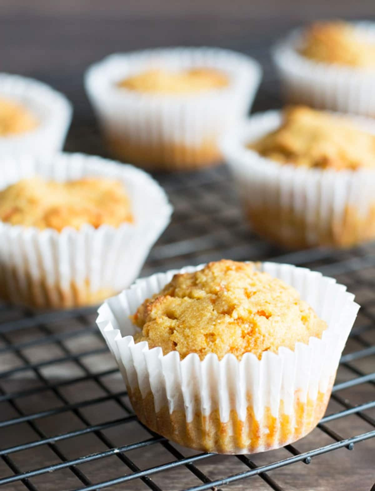gluten free carrot muffins on a cooling rack