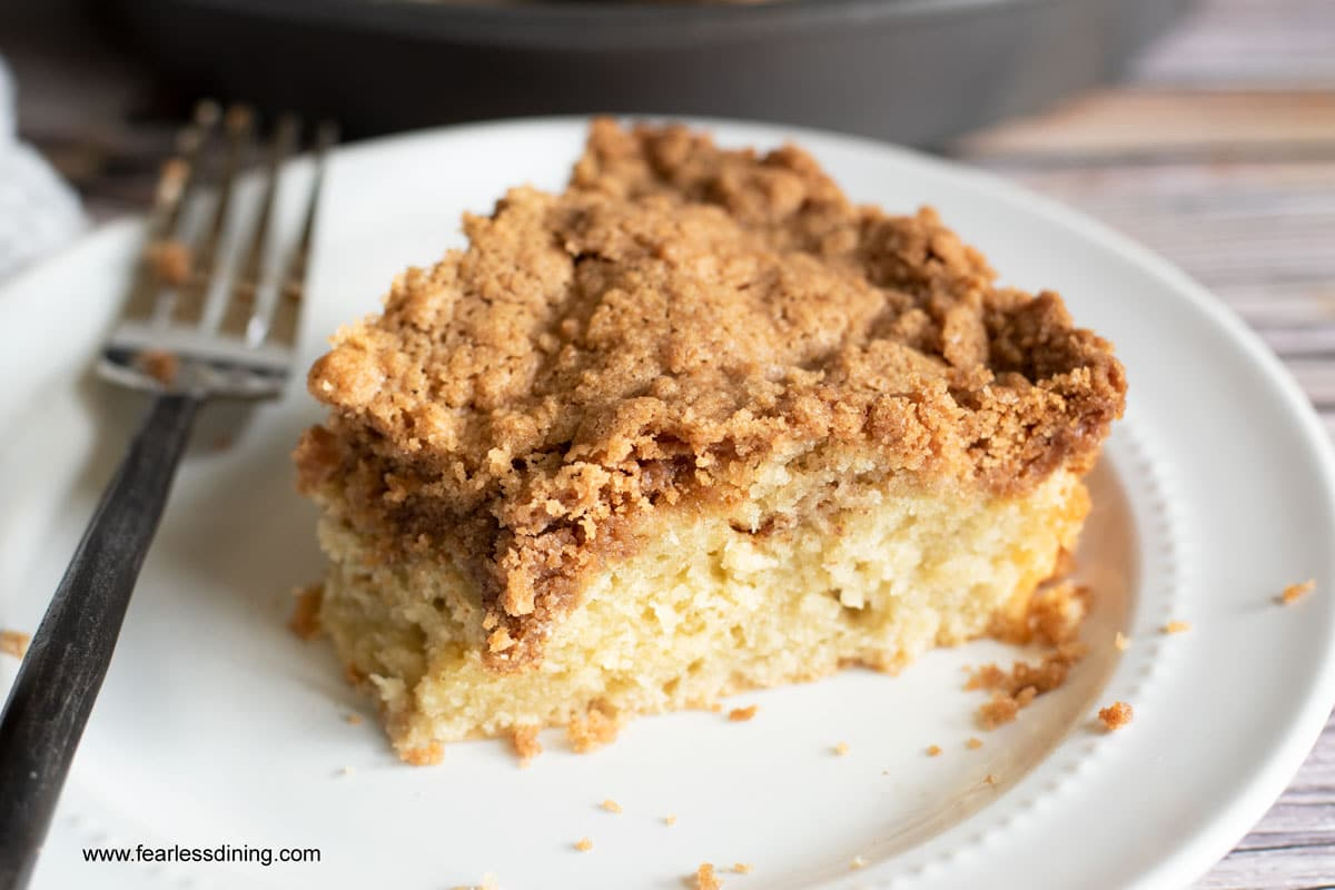 a slice of crumb cake with a piece cut out with a fork