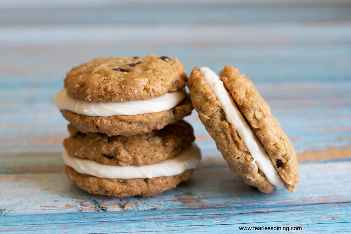three oatmeal cream pies on a blue table