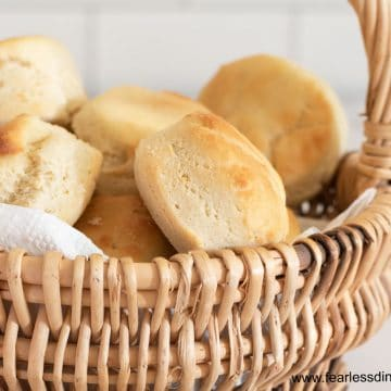 a close up of dinner rolls in a basket