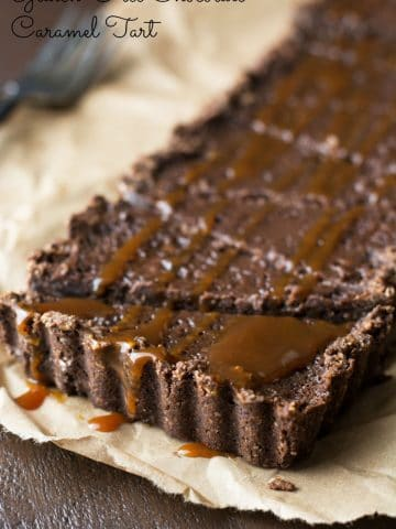 a whole gluten free chocolate tart sliced