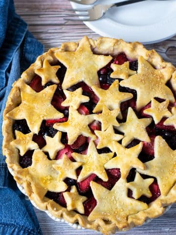 the top view looking down at a mixed berry pie. The top crust is cut into star shapes