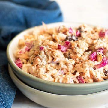 a bowl full of curried tuna salad