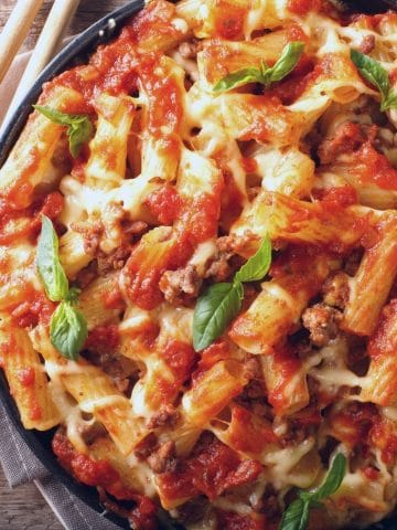 a big bowl filled with ziti with gluten free pasta sauce