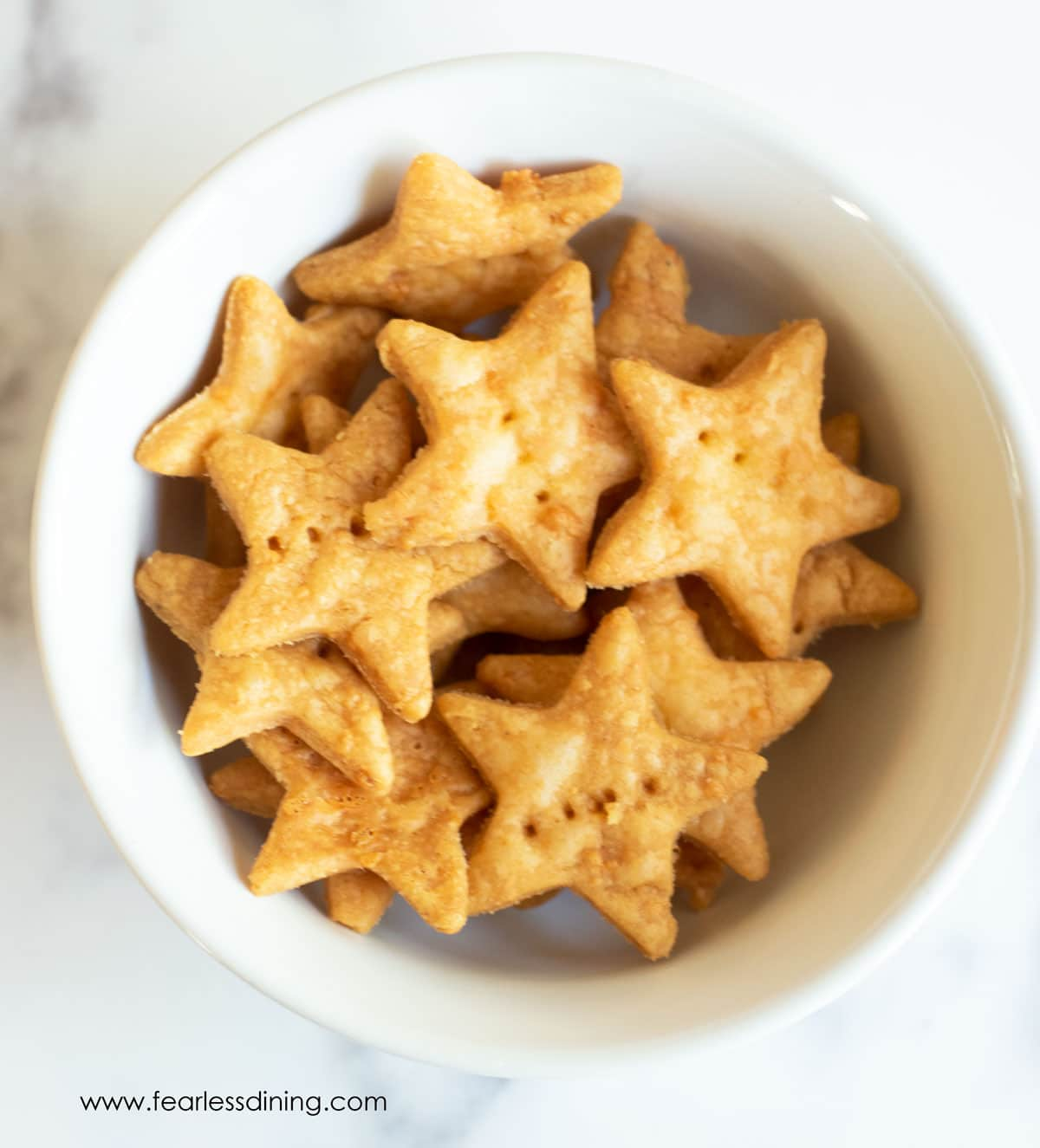 star shaped gluten free cheez its in a white bowl