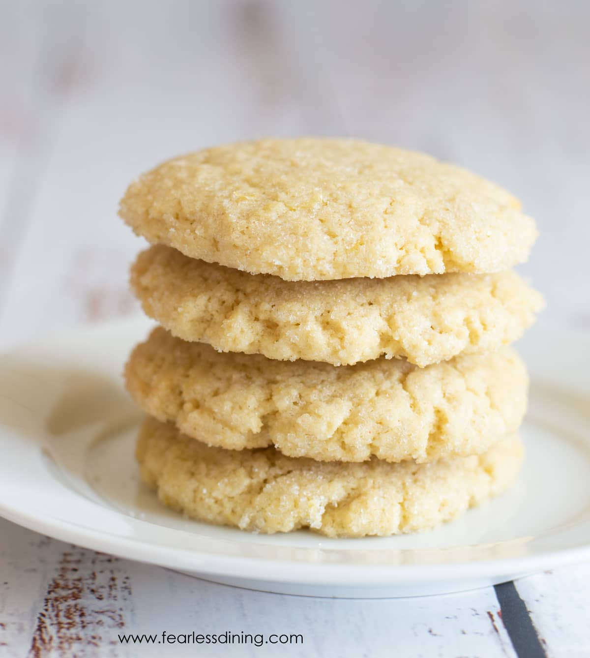 a stack of lemon cookies on a plate