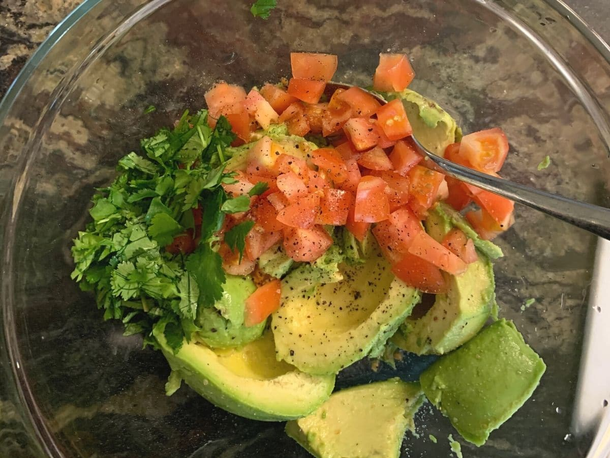 guacamole ingredients in a large glass bowl