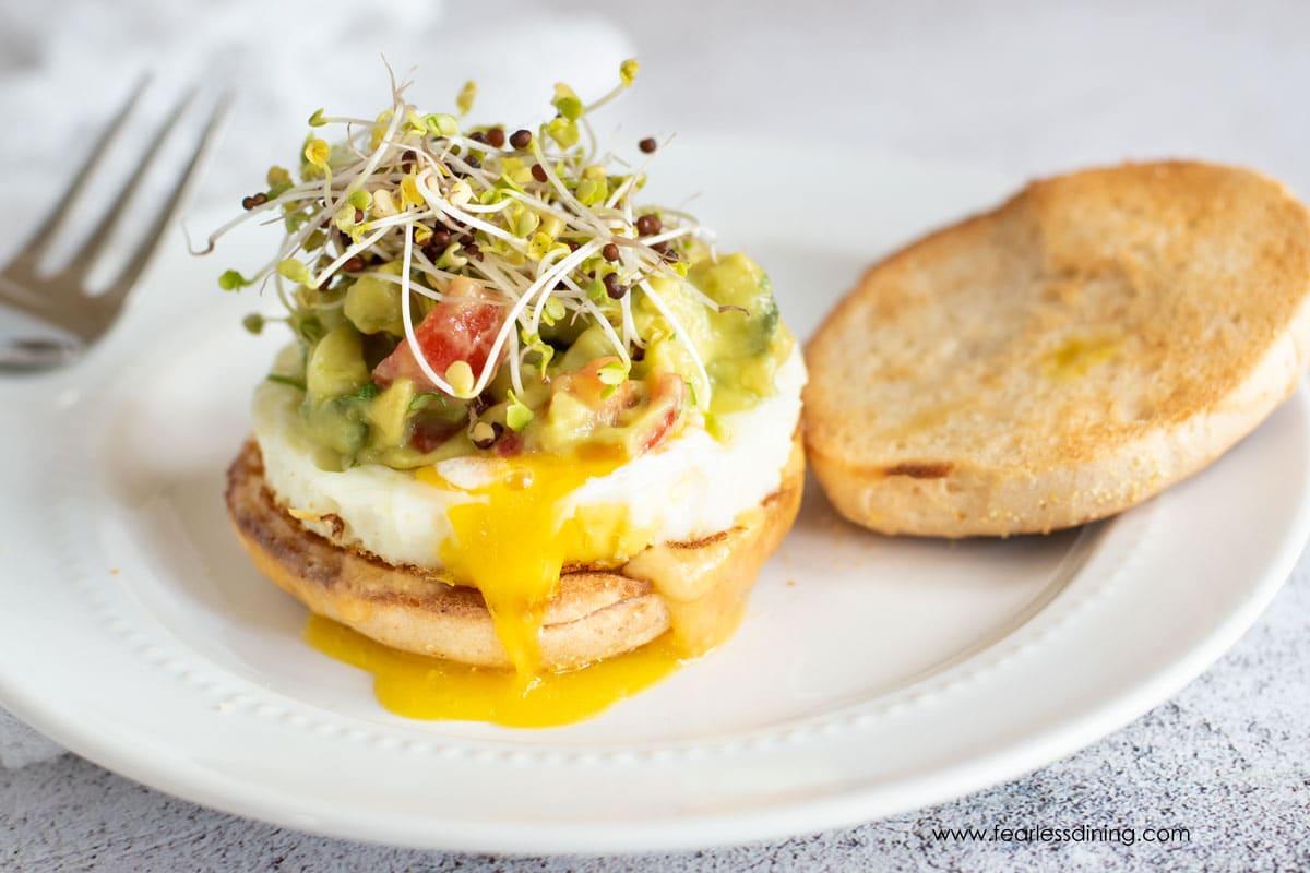 a gluten free breakfast sandwich on a white plate