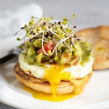 gluten free breakfast sandwich on a white plate