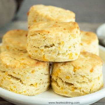 a plate stacked with gluten free cheddar biscuits