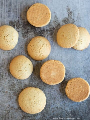 a cookie sheet with baked gluten free vanilla wafer cookies