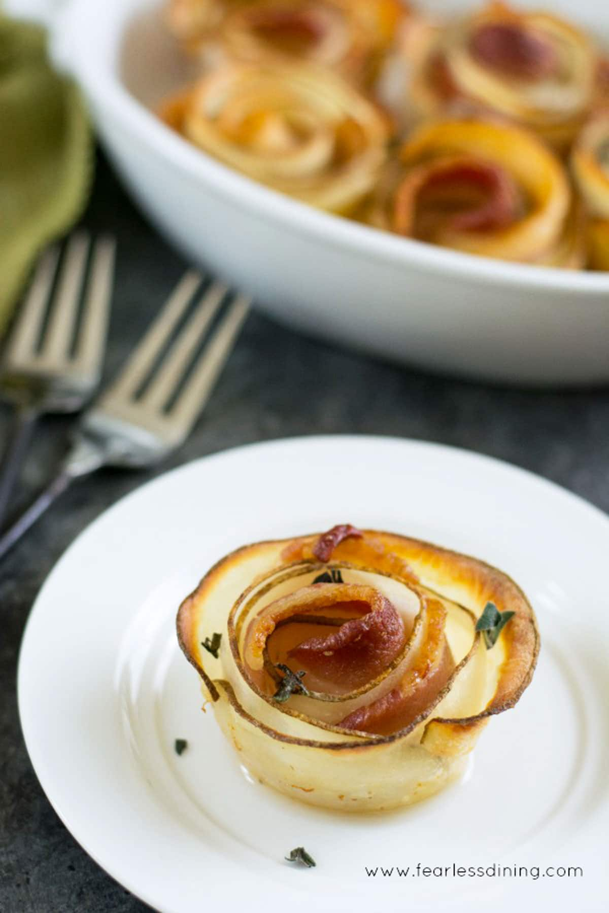 a bacon potato rose on a plate