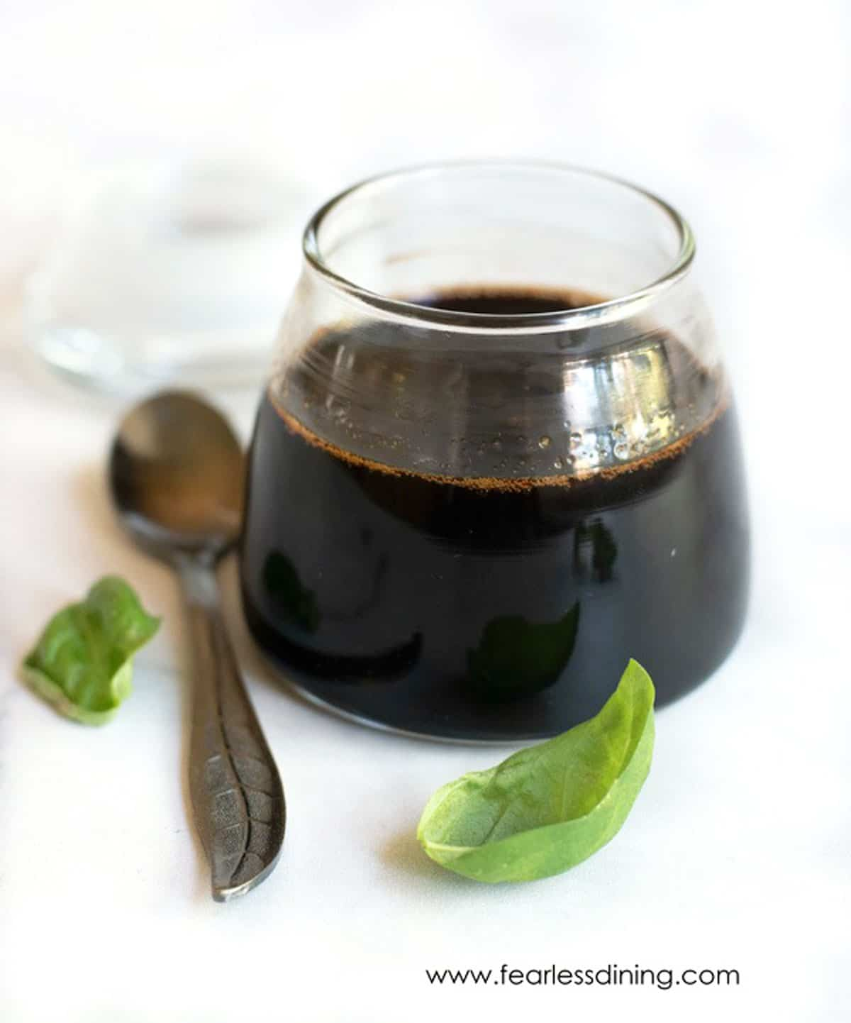 a glass filled with balsamic reduction sauce