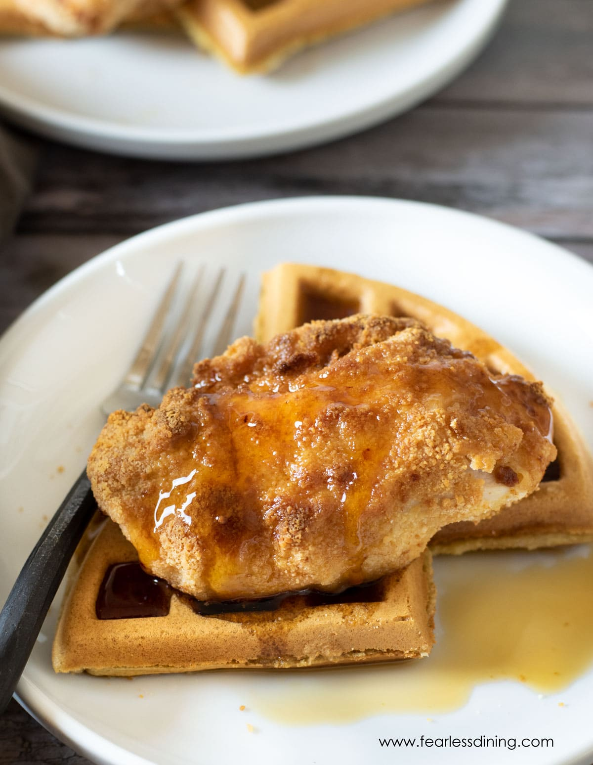 chicken and waffles on a plate with syrup