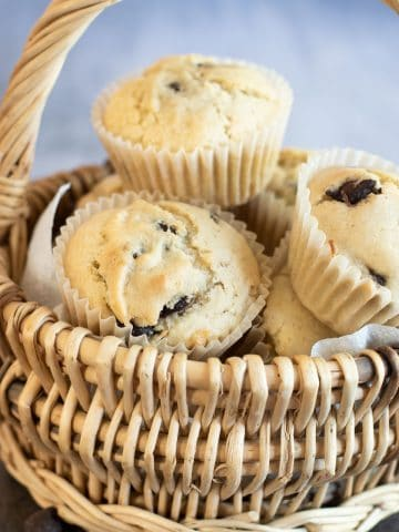 a basket full of vegan chocolate chip muffins