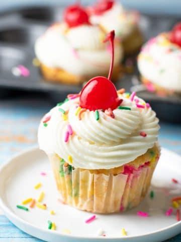 a gluten free funfetti cupcake on a small white plate