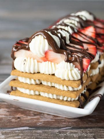 a gluten free icebox cake topped with strawberries