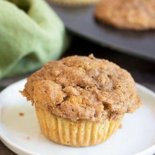 a peach streusel muffin on a plate