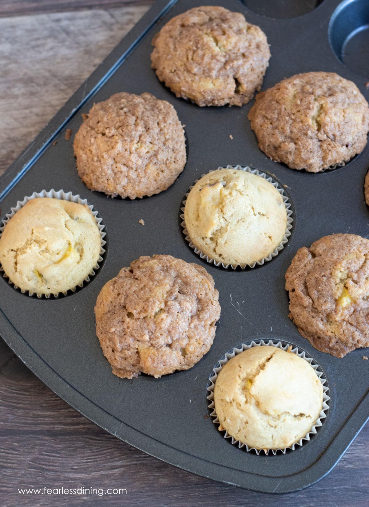 peach muffins in a muffin tin