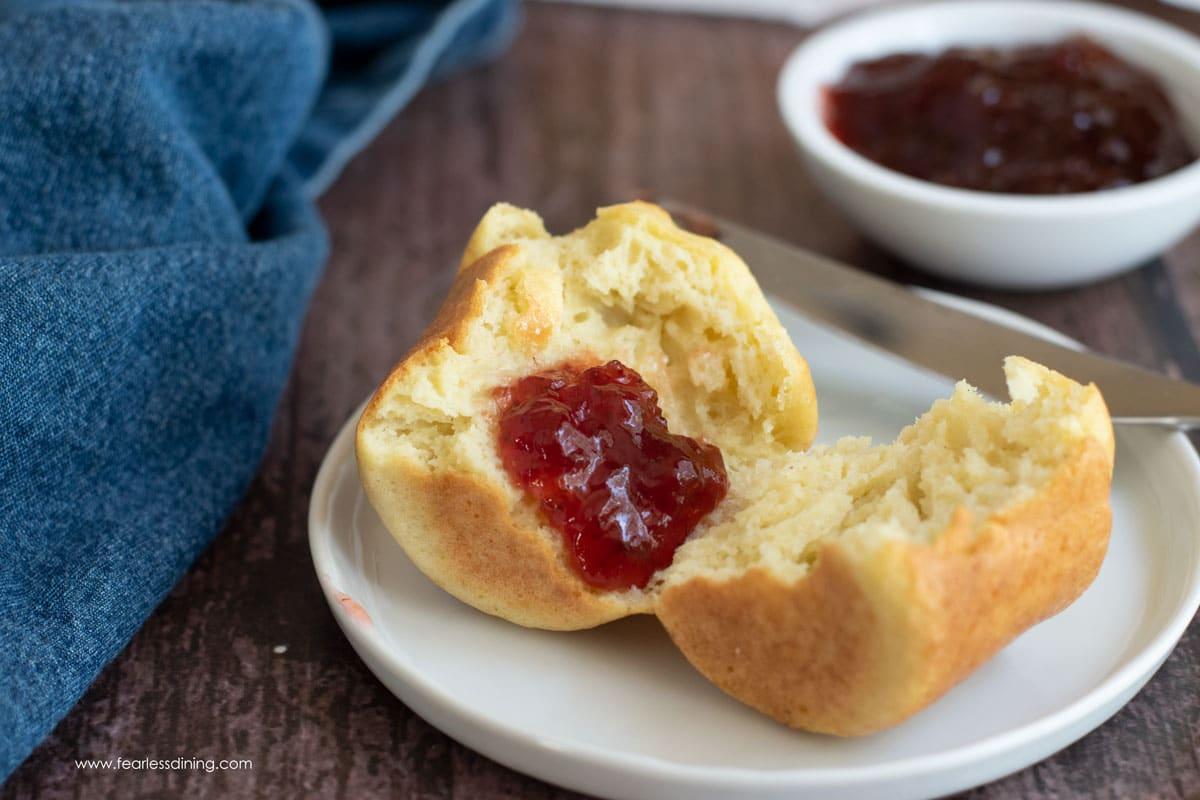 a gluten free popover cut in half with jam