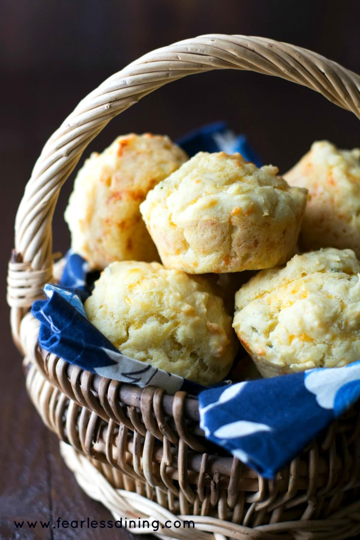 a basket filled with gluten free cheese muffins