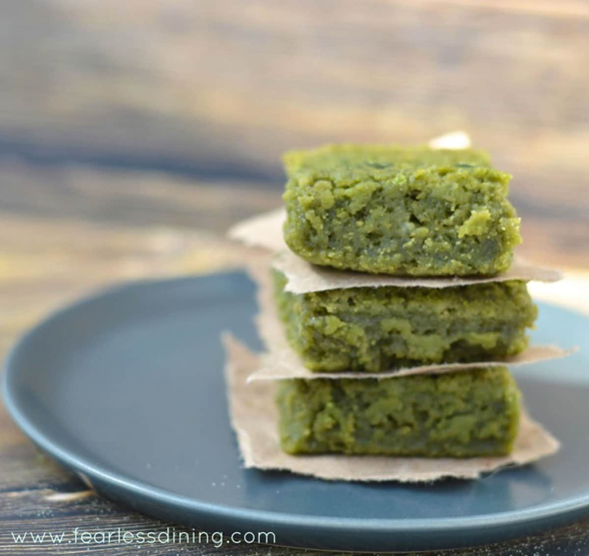 a stack of matcha mochi on a grey plate