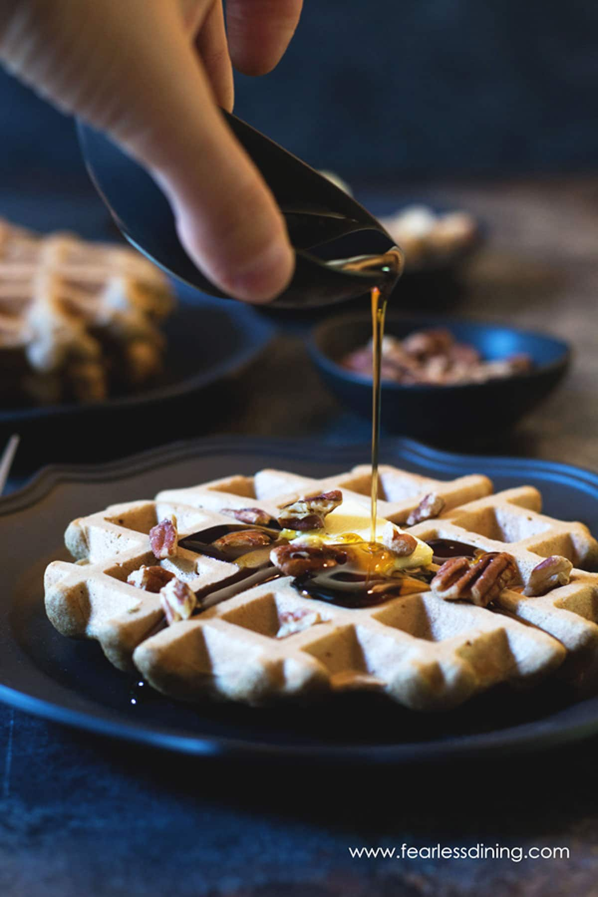 pouring syrup on banana flour waffles